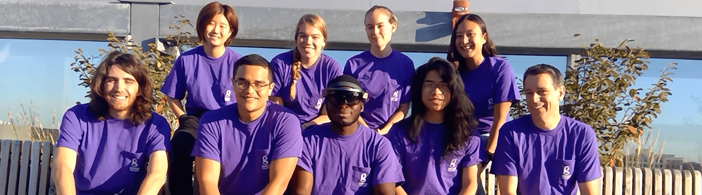 Group of Gemstone students outside, wearing matching purple tshirts